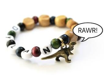 Dinosaur Party Favor Charm bracelet. Wood beads, Personalized name bracelet. Party Favor for boys. Little boy dinosaur bracelet jewelry