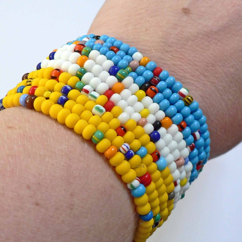 Set of 10 CoLoRFuL RAINBOW seed bead bracelets on a yellow image 0