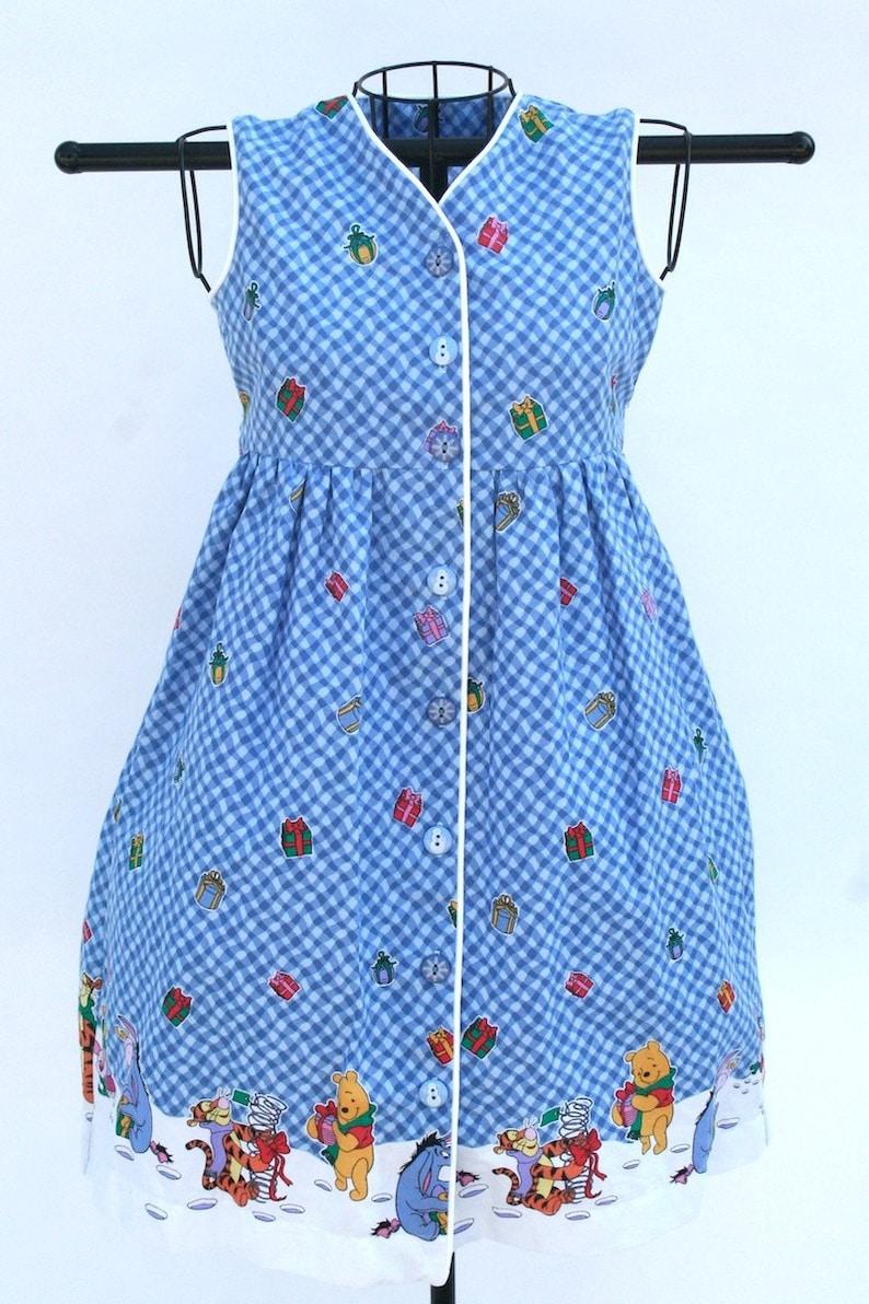 Girl's festive Winnie-the-Pooh dress image 0