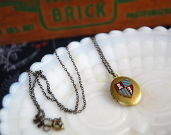 coat of arms vintage enamel locket- shield- crest - brass necklace