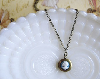 tiny brass vintage cameo locket in sky blue.