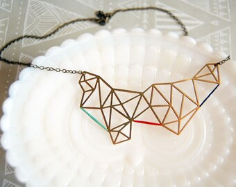 modern geometry enamel accented raw brass necklace