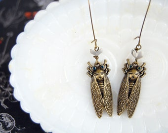 antiqued brass cicada dangle earrings with howlite chevron arrowhead accent- kidney wires