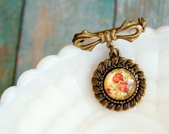 vintage floral print brooch with bow detail - aged brass- mustard yellow