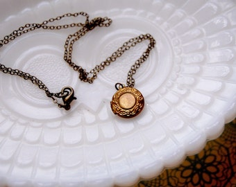 simple secrets vintage brass locket- engraved- antique brass