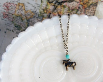 antique brass dala horse necklace with teal bead detail