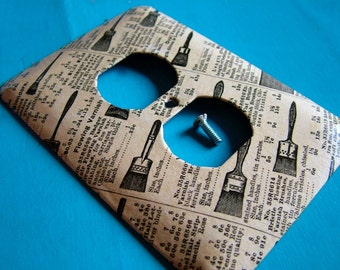 Don't Brush Me Off -- upcycled outlet cover (with vintage 1969 Sears and Roebuck catalog page)