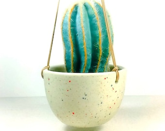 NEW. An eye-catching Hanging Planter for a 3-4 inch pot, glazed in our Sweet Tooth color speckle glaze