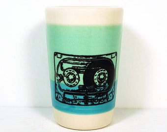 Itty Bitty Cylinder / Vase / Cup with a Mix Tape / Cassette print on Blue Green/Turquoise Blue color block.