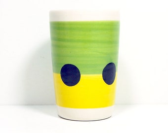 itty bitty cylinder / vase / cup with a black polkadot belt print on leaf green/lemon butter yellow color block, made to order.
