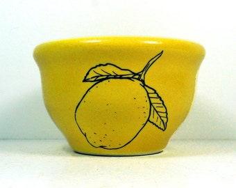 A wee bowl with Lemon prints on Lemon Butter glaze. Ready to Ship.