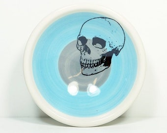 A Small Dish, with a Badass Skull shown here on a color block of Cloudless Blue + Storm.