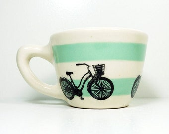 12oz Cup with a Speedy Delivery Bike print, shown here on stripes of Blue Green underglaze. Pick Your Color/Pick Your Print