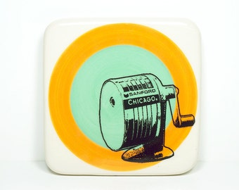 tile of a Chicago Sanford pencil sharpener on a color block of orange and blue green, made to order.