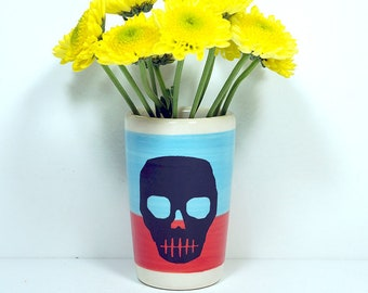 itty bitty cylinder / vase / cup with a voodoo skull rpint on red-orange/cloudless blue color block, made to order.