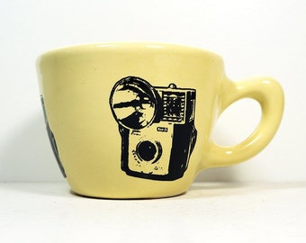 12oz cup with Starmite camera prints on it, shown here on Buttercream glaze. Made to Order / Pick Your Color / Pick Your Print