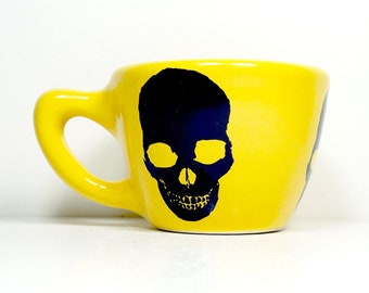12oz Cup/Mug with a Skull Silhouette print, shown here on Lemon Butter Yellow glaze. Pick Your Color/Pick Your Print