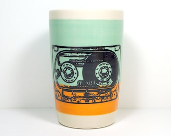 18oz smoothies/coffee/beer/water tumbler with a mix tape on a colour block of blue green & creamsicle. Made to Order.