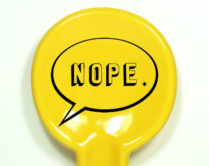 Featured listing image: spoon rest shown here in Lemon Butter, with NOPE word bubble.  Made to Order / Pick Your Colour