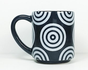 STACKABLE 15oz coffee mug/tea mug with White Bullseyes all over, shown here in Blackest Black glaze. Made to Order.