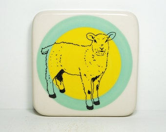 tile featuring a sheep, on a color block of blue green and yellow. Ready to Ship.
