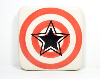 tile with a star on a red-orange bullseye, made to order.