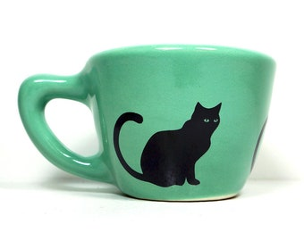 12oz cup with a black cat silhouette print, shown here on mint blue-green glaze - Made to Order / Pick Your Color