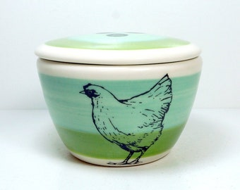 a lidded bowl / jar with a Chicken/Hen print shown here on a Blue Green/Leaf Colorblock. Made to Order / Pick Your Print