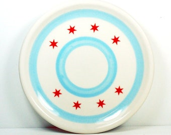 A fine little plate with the Chicago Flag motif. Made to Order.