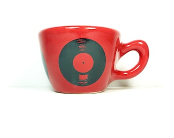 12oz cup featuring an LP Record print, shown on berry red glaze, Made to Order/ Pick Your Colour