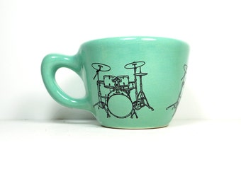 12oz cup with a drumkit print, shown here on blue-green glaze - Made to Order / Pick Your Colour