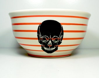 A fabulous large bowl featuring a detailed Skull silhouette print on Red-Orange pinstripes
