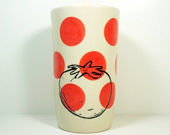 a tall cylinder/vase/utensil holder with a tomato print on red-orange polkadots, Made to Order.