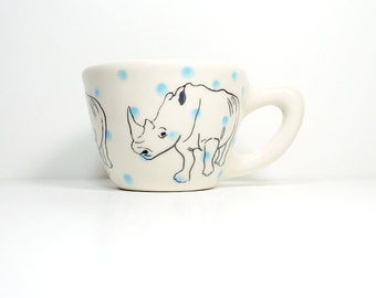 12oz cup with a rhino print, shown here on cloudless blue polkadots - Made to Order / Pick Your Colour