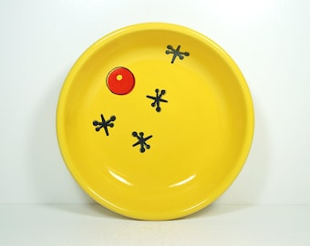 lo bowl with a print of the game of Jacks on it, shown on a Lemon Butter yellow, Made to Order / Pick Your Colour