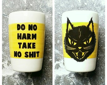 "18oz tumbler w/the phrase ""Do No Harm Take No Shit"" & Kitty Black Cat prints, here on a wide band of yellow. Made to Order/Pick Your Color"