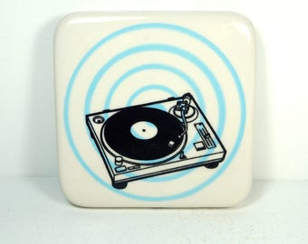 tile with a pinstripe bullseye in blue with a turntable print, ready to ship