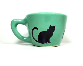 12oz cup with a black cat silhouette print, shown here on blue-green glaze - Made to Order / Pick Your Colour