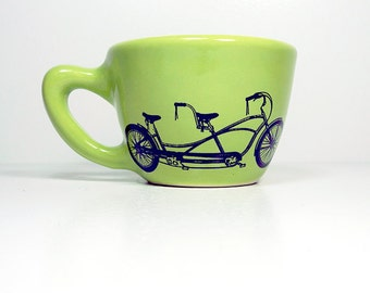 12oz cup featuring a tandem bike print, shown here on tinda green glaze - Made to Order / Pick Your Colour