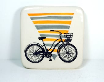 tile with orange and grey gray background and a Speedy Delivery bike with basket print, ready to ship