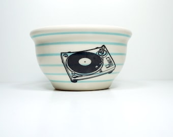 small bowl with pinstripes (shown here in sky blue) and a turntable print. Made to Order / Pick Your Colour