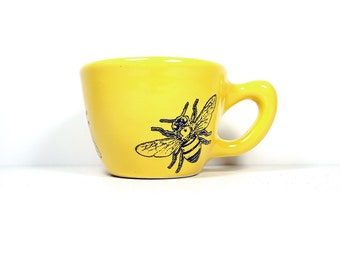 12oz cup with a honey bee print on it, glazed in lemon butter yellow glaze -  Made to Order / Pick Your Colour