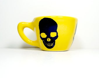 12oz cup with a skull silhouette print, shown here on lemon butter yellow glaze - Made to Order / Pick Your Colour