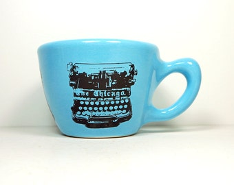 12oz cup with a Chicago typewriter print, shown here on cloudless blue glaze - Made to Order / Pick Your Colour