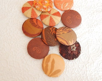 11 rust orange fabric covered buttons, size 75