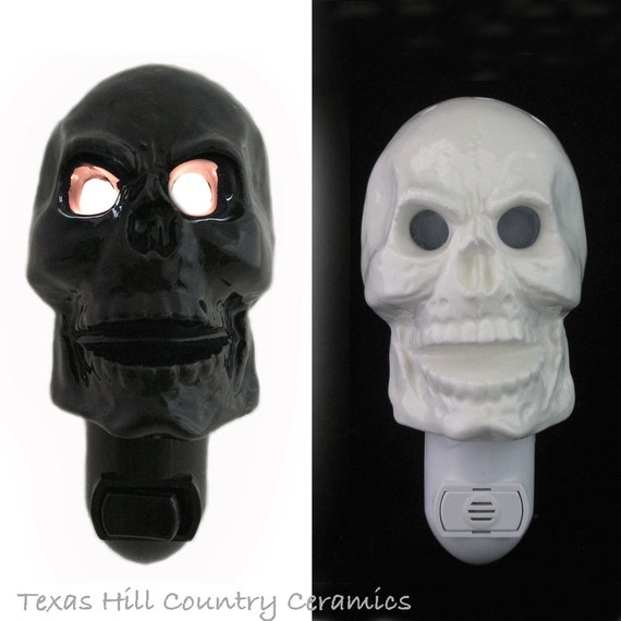 Ceramic Skull Night Light with Sinister Glowing Eye Sockets, Halloween Skulls in Black or White for Decorating at Home or Office