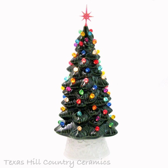 Ceramic Christmas Tree Christmas in Our Hearts Classic 10 Inch Tall Electric Lighted Evergreen Tree White Base Color Lights Choice of Star