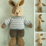 Toy knitting pattern for a bunny rabbit with a piebald patch, shorts and a stripy sweater