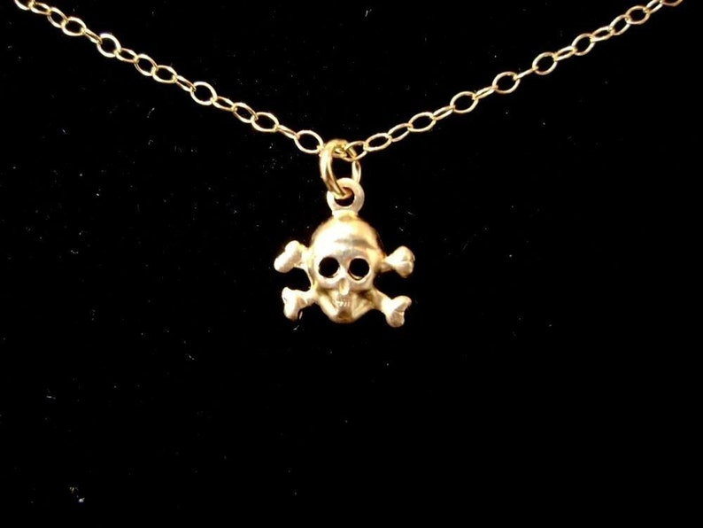 Teensy Tiny Gold Skull and Crossbones Necklace image 0