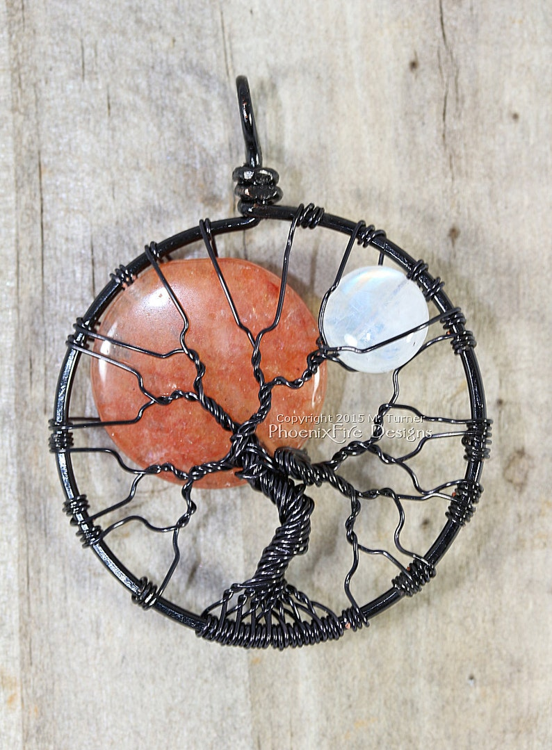 Solar Eclipse Sun and Moon Tree of Life Pendant Black Wire image 0